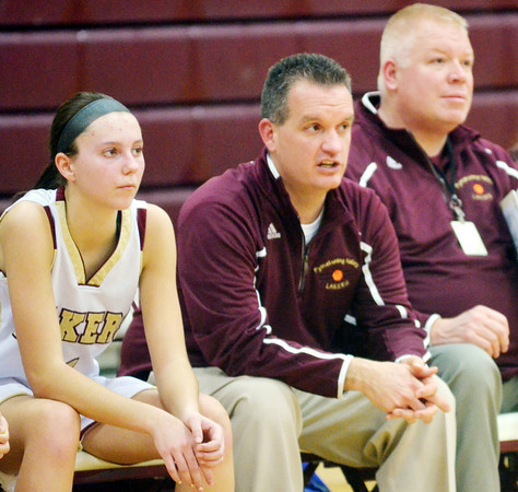 WARREN DILLAWAY / Star Beacon<br /> JEFF COMPAN, Pymatuning Valley girls basketball coach, (center) watches the action with Abby Hamilton and assistant coach Steve Urcheck on Monday evening during a home game with Mathews.