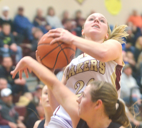 WARREN DILLAWAY / Star Beacon<br /> GEENA GABRIEL (21) of Pymatuning Valleyis fouled by a Mathews defenders while hitting a layup on Monday evening in Andover Township.