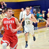 WARREN DILLAWAY / Star Beacon<br /> ZAC SWEAT (14) of Geneva drives up court as Richie Burr of Conneaut (12) and Spartan teammate Dylan Campbell (14) follow the play on Tuesday night at Garcia  Gymnasium in Conneaut.