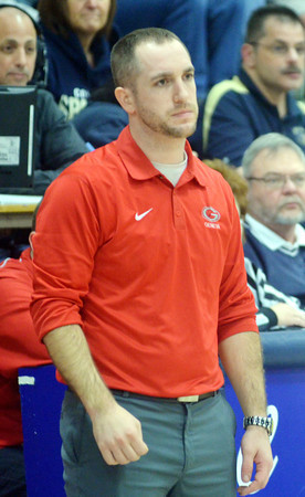 WARREN DILLAWAY / Star Beacon<br /> MATT VESPA, Geneva boys basketball coach, watches the action on Tuesday evening at Conneaut.