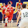 WARREN DILLAWAY / Star Beacon<br /> ZAC SWEAT (14) of Geneva drives up court as Richie Burr of Conneaut (12) waits for him at mid court on Tuesday at Garcia  Gymnasium in Conneaut.