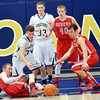 WARREN DILLAWAY / Star Beacon<br /> JUSTIN MYERS (34) of Conneaut loses control of the ball while Geneva defenders Steve Jewell (right) and Brandon Kovach (10 on floor) reach for the ball with Eagle Ryan Mackynen (40) and Spartan Ryan Oatman (33) looking on Tuesday night at Garcia Gymnasium.