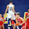 WARREN DILLAWAY / Star Beacon<br /> ZAC SWEAT (14) of Geneva looks for an angle to the basket as Jake Spees of Conneaut goes airborn on Tuesday evenig at Garcia Gymnasium in Conneaut.