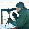 WARREN DILLAWAY / Star Beacon<br /> ROGER REDMOND of Conneaut uses a telescope to watch birds from a Lake Shore Park Pavilion in Ashtabula Township on Tuesday afternoon.