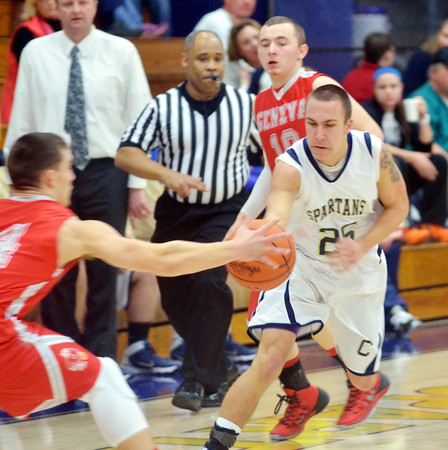 WARREN DILLAWAY / Star Beacon<br /> KYLE SPRINKLE (25) of Conneaut and Zac Sweat (14) of Geneva lunge for the ball on Tuesday night at Conneaut.