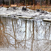 WARREN DILLAWAY / Star Beacon<br /> MELTING SNOW created a huge puddle along the Greenway Trail near the Route 307 intersection in Austinburg Township on Tuesday morning.