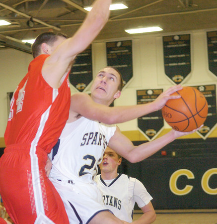 WARREN DILLAWAY / Star Beacon<br /> MARCUS BARRICKMAN (25) of Conneaut tries to drive around Tyler Drought (left) of Geneva on Tuesday night at Garcia Gymnasium in Conneaut.
