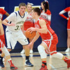 WARREN DILLAWAY / Star Beacon<br /> RYAN OATMAN (33) of Conneaut defends Zac Sweat (14) of Geneva lunge for the ball on Tuesday night at Conneaut.