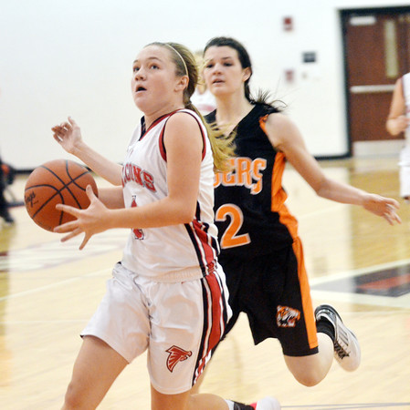 WARREN DILLAWAY / Star Beacon<br /> EMILY SMOCK of Jefferson drives to the basket with Alissa Abraham of Newton Falls in hot pursuit on Thursday at Jefferson.