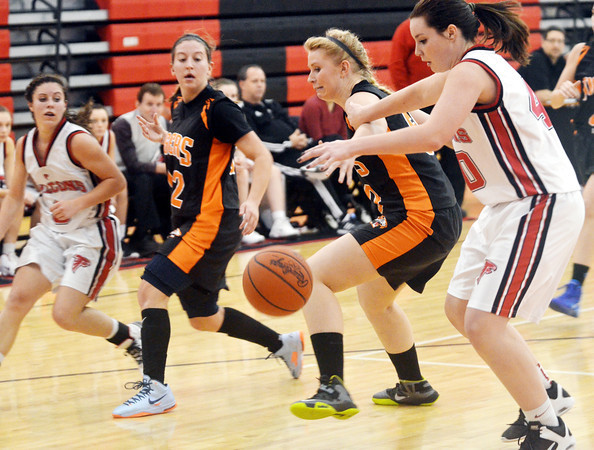 WARREN DILLAWAY / Star Beacon<br /> SARAH BROOK (far right) and Jefferson teammate Jessica Becker (far left) race for a loose ball with two Newton Falls defenders on Thursday night in Jefferson.