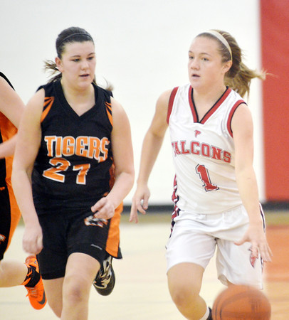 WARREN DILLAWAY / Star Beacon<br /> EMILY SMOCK of Jefferson dribbles up court with Hannah Zelle of Newton Falls in hot pursuit on Thursday night at Jefferson.