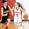 WARREN DILLAWAY / Star Beacon<br /> GABBY WAGNER (5) of Jefferson dribbles up court with Destinee Hutson of Newton Falls in hot pursuit on Thursday night in Jefferson.