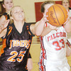 WARREN DILLAWAY / Star Beacon<br /> NATALIE HAMSKI (33) of Jefferson and Tia Harris of Newton Falls fight for the ball on Thursday night at Jefferson.