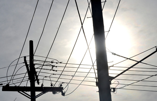 WARREN DILLAWAY / Star Beacon<br /> UTILITY POLES are silhouetted along Park Avenue in Ashtabula on Thursday afternoon.