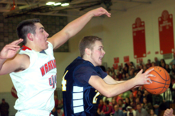 WARREN DILLAWAY / Star Beacon<br /> MARCUS BARRICKMAN (right) of Conneaut grabs a rebound in front of Matt Fitchet of Edgewood on  Friday night at Edgewood.