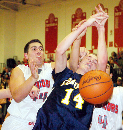 WARREN DILLAWAY / Star Beacon<br /> MARCUS BARRICKMAN (14) of Conneaut fights for a rebound with Matt Fitchet (left) of Edgewood on Friday night at Edgewood.