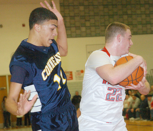 WARREN DILLAWAY/ Star Beacon<br /> ANTHONY MONDAY (22) of Conneaut grabs a rebound in front of Jake Spees of Conneaut on Friday night at Edgewood.