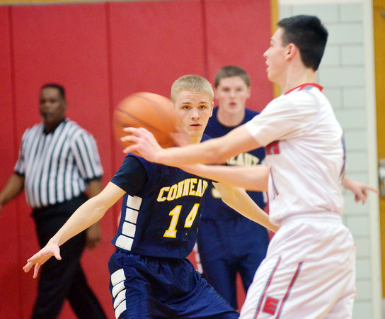 WARREN DILLAWAY / Star Beacon<br /> DYLAN CAMPBELL (14) of Conneaut defends Joey Zappitelli (foreground) of Edgewood on Friday night at Edgewood.