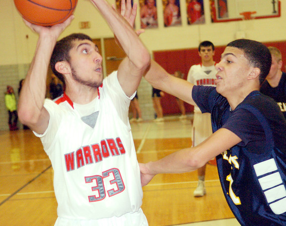 WARREN DILLAWAY / Star Beacon<br /> ELI KALIL (33) of Edgewood prepares to shoot with Jake Spees of Conneaut defending on Friday night at Edgewood.