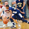 WARREN DILLAWAY / Star Beacon<br /> JUSTIN FRANKLIN of Conneaut attempts to find a way by Anthony Monda (22) of Edgewood on Friday night at Edgewood.