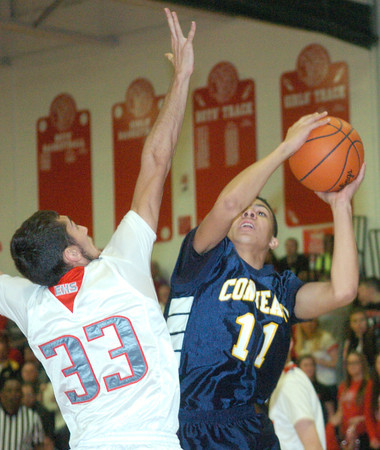 WARREN DILLAWAY / Star Beacon<br /> JAKE SPEES (11) of Conneaut prepares to shoot as Elii Kalil of Edgewood defends on Friday at Edgewood.