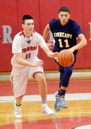 WARREN DILLAWAY / Star Beacon<br /> JOEY ZAPPITELLI of Edgewood dribbles up court with Jake Spees of Conneaut in hot pursuit on Friday at Edgewood.