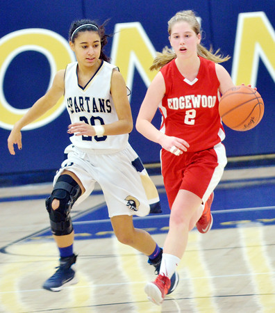 WARREN DILLAWAY / Star Beacon<br /> CARRIE PASCARELLA (2) of Edgewood brings the ball up court with Alyssa Chadwick of Conneaut in hot pursuit on Saturday at Conneaut.