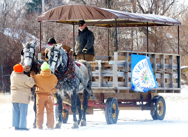 WARREN DILLAWAY / Star Beacon<br /> A HORSEDRAWN wagon is prepared for My Neighborhood Winter Fun Day at a city park near the intersection of Madison and West 58th streets in Ashtabula Saturday afteroon.