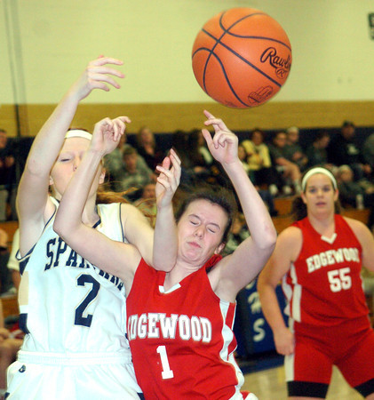 WARREN DILLAWAY / Star Beacon<br /> HALEY HOLDEN (1) of Edgewood battles for a rebound with Keely Cole of Conneaut on Saturday during a game at Garcia Gymnasium in Conneaut.
