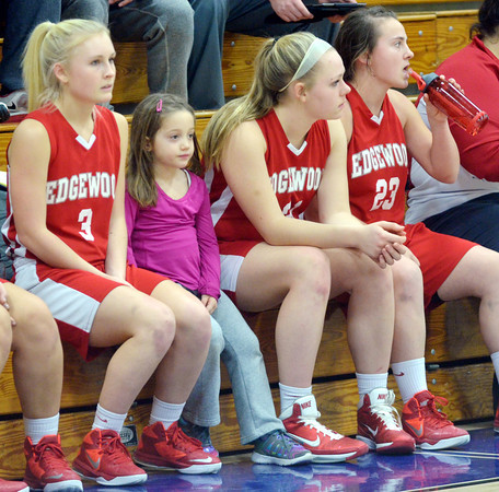 WARREN DILLAWAY / Star Beacon<br /> CARLY KRAY (second from left), daughter of Edgewood girls basketball coach Steve Kray,  sits on the bench with Kate Crooks (3) on Saturday afternoon at Conneaut.