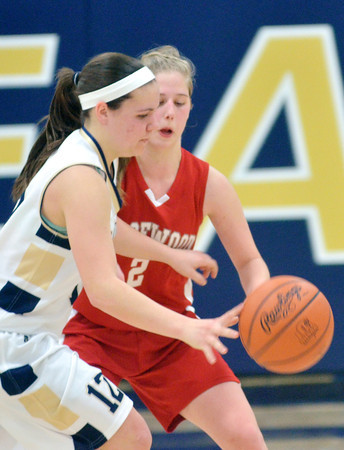 WARREN DILLAWAY / Star Beacon<br /> BROOKE BENNETT of Conneaut tries to evad Carrie Pascarella of Edgewood on Saturday at Garcia Gymnasium in Conneaut.