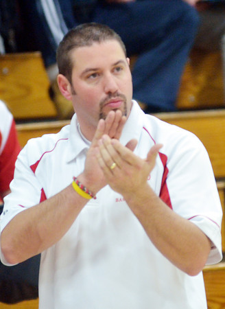 WARREN DILLAWAY / Star Beacon<br /> STEVE KRAY, Edgewood girls basketball coach, encourages his team on Saturday during a game at Conneaut's Garcia Gymnasium.