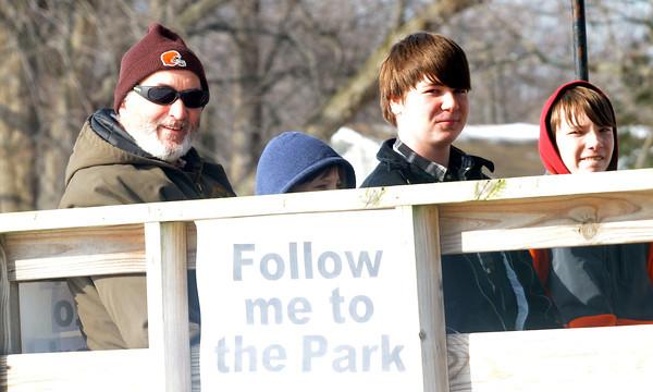 WARREN DILLAWAY/ Star Beacon<br /> DAVID GOGUL (left) and his grandsons (from left) Zachary Stafford, Jacob Dixon and Austin Dixon enjoy horsedrawn wagone ride on Saturday during My Neighbordhood Winter Fun Day in Ashtabula.
