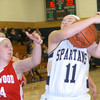 WARREN DILLAWAY / Star Beacon<br /> ANGELA COLE of Conneaut (11) grabs a rebound in front of Taylor Diemer of Edgewood (34) on Saturday afternoonn at Conneaut's Garcia Gymansium.