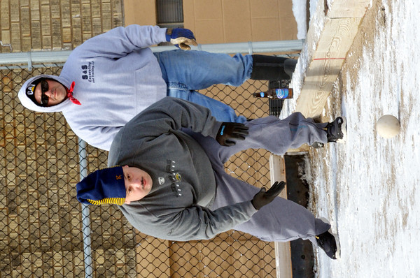 WARREN DILLAWAY / Star Beacon<br /> TERRY GUERRIERO (left) and Steve Severino, both of Ashtabula participate in the First Annual Sons of Italy Outdoor Bocce Tournament on Saturday in Ashtabula.