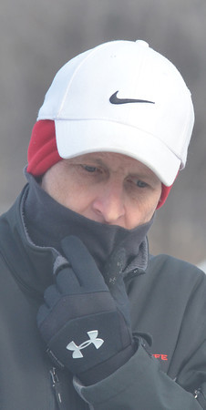 WARREN DILLAWAY / Star Beacon<br /> DOUG CARTER of Wickliffe tries to stay warm during the First Annual Sons of Italy Outdoor Bocce Tournament on Saturday in Ashtabula.