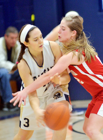 WARREN DILLAWAY / Star Beacon<br /> NATALIE BERTALASIO (left) of Conneaut tries to throw a pass by  Carrie Pascarella of Edgewood on Saturday during a game at Conneaut's Garcia Gymnasium.