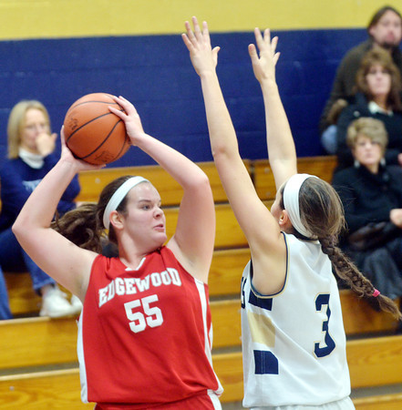 WARREN DILLAWAY / Star Beacon<br /> CORTNEY HUMPRHEY of Edgewood (55) looks for an open teammate while Natalie Bertolasio of Conneaut defends on Saturday at Conneaut's Garcia Gymnasium.