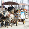 WARREN DILLAWAY / Star Beacon<br /> A HORSEDRAWN wagon hit Ashtabula streets on Saturday during  My Neighborhood Winter Fun Day. The event was based at a city park near the intersection of Madison and West 58th streets .