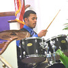 WARREN DILLAWAY / Star Beacon<br /> NATE JONES plays the drums during a Martin Luther KIng Jr. memorial service on Monday afernoon at Hiawatha Church of God in Christ in Ashtabula.