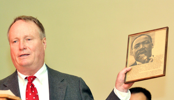 WARREN DILLAWAY / Star Beacon<br /> CONGRESSMAN DAVID JOYCE of Russell Township displays a plaque he keeps in his office honoring Dr. Martin Luther King Jr. Joyce spoke at a memorial to the Civil Rights leader held Monday morning at St. Peter's Episcopal Church in  Ashtabula. The event was sponsored by the Kiwanis Club of Ashtabula.