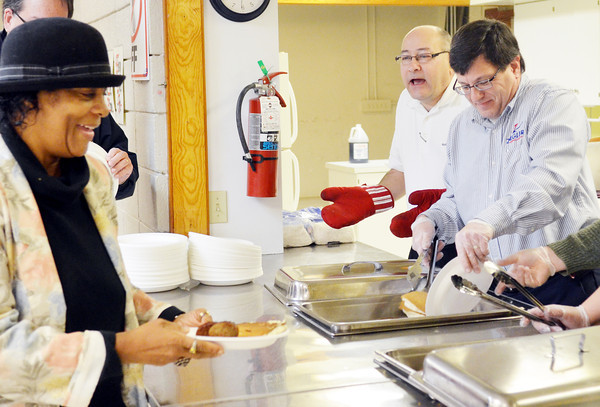 WARREN DILLAWAY / Star Beacon<br /> SHEILA JEMISON (left) is served by Gerry Giangola (left back) and Tim Volpone (right back) at a breakfast honoring Martin Luther King Jr. on Monday morning at St. Peter's Episcopal Church in Ashtabula. The event was sponsored by the Kiwanis Club of Ashtabula.