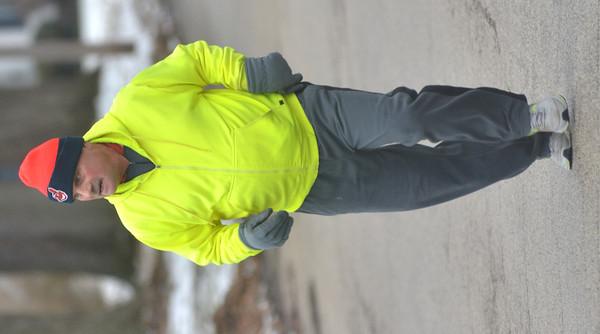 WARREN DILLAWAY / Star Beacon<br /> ROBERT MACKEY of Ashtabula runs along Ohio Avenue in Ashtabula Harbor on Monday morning.