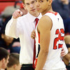 WARREN DILLAWAY / Star Beacon<br /> STEVE FRENCH, Jefferson coach, instructs James Jackson on Tuesday during a home game with Austintown Fitch.