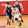 WARREN DILLAWAY / Star Beacon<br /> SAGE CANTINI (11) of Jefferson dribbles up court with Gabriel Chekpke (4) inhot pursuit on Tuesday evening at Jefferson.