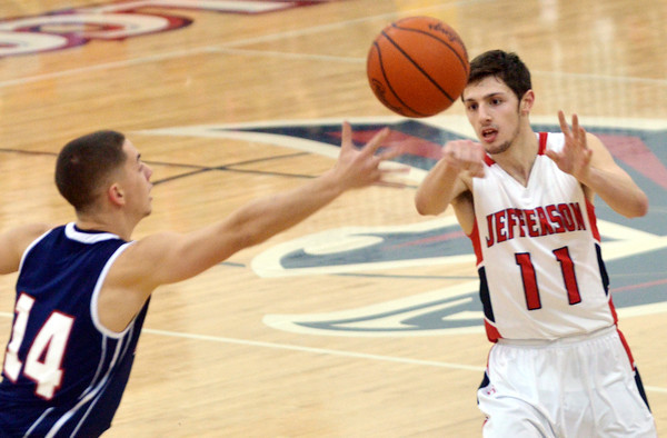 WARREN DILLAWAY / Star Beacon<br /> SAGE CANTINI (11) of Jefferson passes to a teammate by the finger tips of Nick Pence of Austintown Fitch on Tuesday evening at Jefferson.