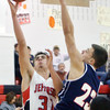 WARREN DILLAWAY / Star Beacon<br /> LUCAS HITCHCOCK (31) of Jefferson prepares to shoot over Zach Carr (23) of Austintown Fitch on Tuesday at Jefferson.