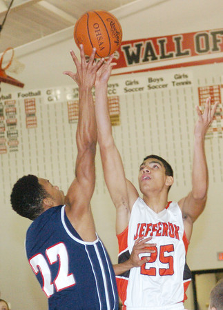 WARREN DILLAWAY / Star Beacon<br /> JAMES JACKSON (25) of Jefferson shoots over Quincy Higgins (22) of Austintown Fitch on Tuesday at Jefferson.