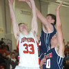 WARREN DILLAWAY / Star Beacon<br /> SAM HITCHCOCK of Jefferson (33) gets his shot blocked by Anthony Pangio (top) of Austintown Fitch with Alex DiFrancesco of Austitown Fitch in the foreground on Tuesday night at Jefferson.