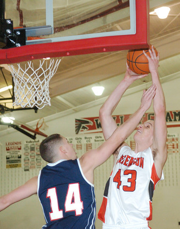 WARREN DILLAWAY / Star Beacon<br /> DAVID CHASE (43) of Jefferson shoots over Nick Pence (14) of Austintown Fitch on Tuesday at Jefferson.